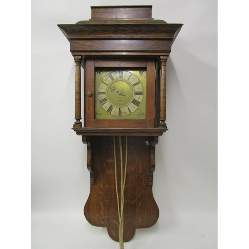 56 - An early 20th century oak cased hooded wall clock, fitted with an early 18th century single handled ...