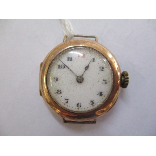86 - An early 20th century gents Rolex yellow metal wristwatch having a white enamel dial with Arabic num...