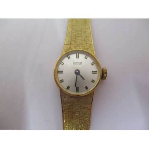 87 - An Orma ladies 14ct gold manual wind wristwatch having a silvered dial with baton markers, blued han...