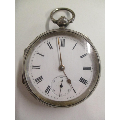 92 - A late 19th century silver cased pocket watch having a white enamel dial, Roman numerals and subsidi...