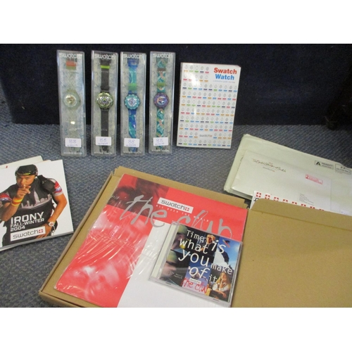 88 - Four cased Swatch Scuba 200 wristwatches, together with Swatch related ephemera and a CD...