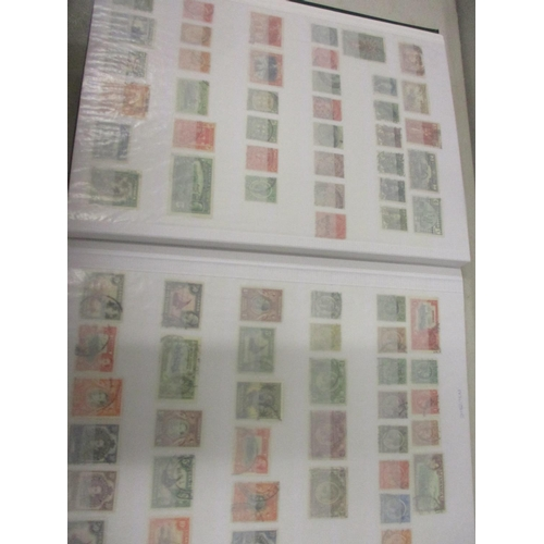 11 - A stock book of used British Colonial stamps, late 19th century to early 20th century...