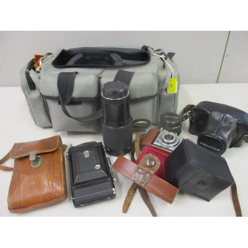 17 - Photographic equipment to include a Pentax 35mm, an Agfa and other items...