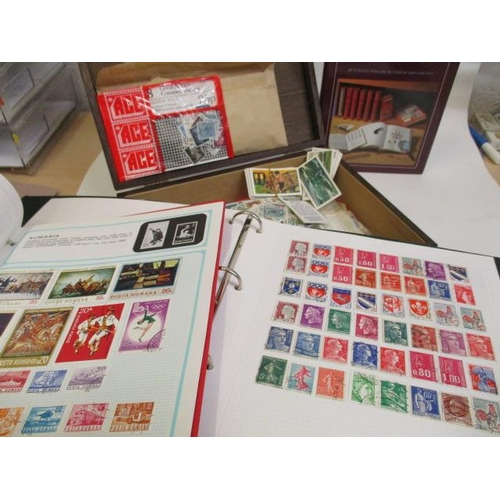 2 - A large quantity of loose stamps and mixed tea cards and three folders of world stamps...