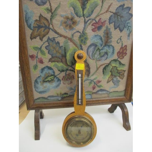 33 - A maple cased barometer and a firescreen...