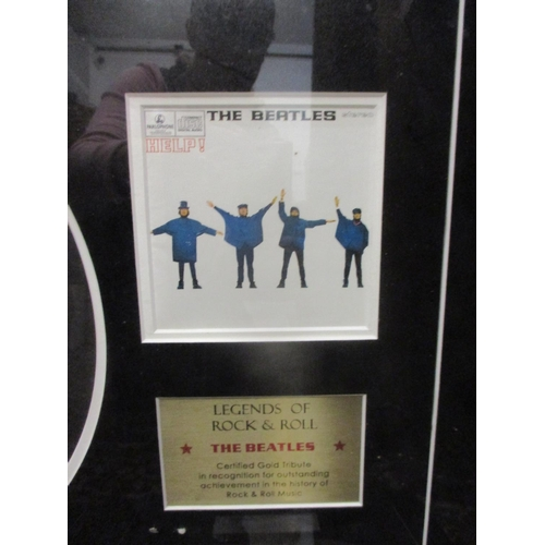 40 - Three framed gold plated records to commemorate the World Wide Sales of Sgt Pepper by The Beatles an...