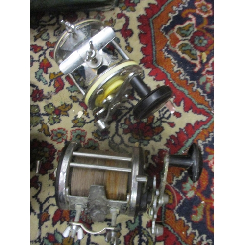 41 - A collection of sea fishing tackle to include multi fly reels, all housed within a green tackle bag ...