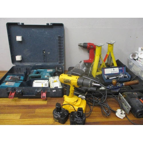 49 - A quantity of DIY tools to include an SDS drill, a car jack, a Dewalt and spanners...