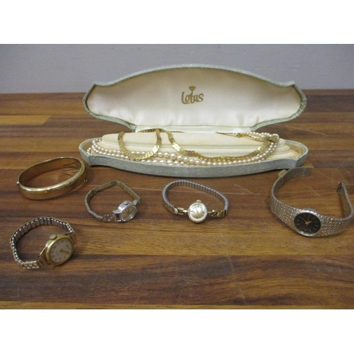 51 - Two ladies Omega wristwatches and two others, together with mixed costume jewellery and a gold plate...