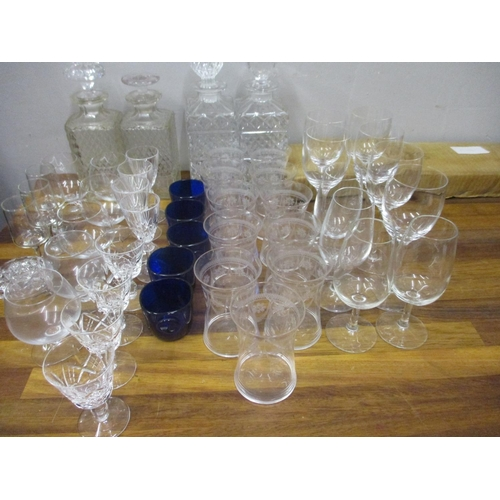 52 - Glassware to include decanters, blue glass condiment liners and drinking glasses...