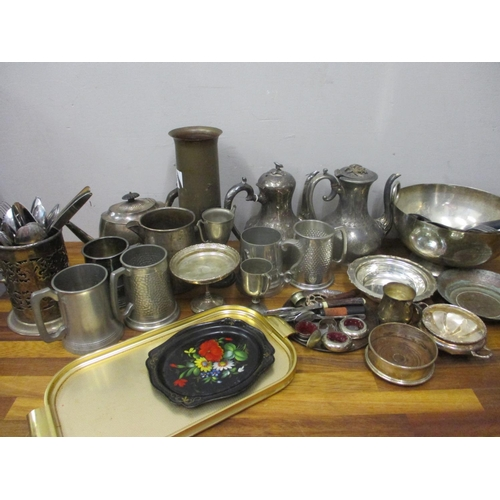 53 - Metalware to include a gun shell case, teapots, a wine bottle coaster and other items...