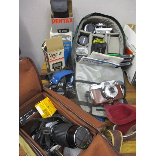 54 - A Chinon CA-4 camera, a vintage contaflex camera, a Pentax Camera, mixed flashes and lenses, two cam...