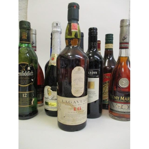 51 - Eleven mixed bottles to include Lagavulin Single Malt Whisky and Remy Martin Cognac Location 5.4...