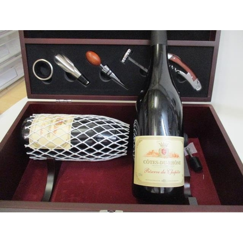 11 - A presentation case having two bottles of Cotes-Du-Rhone and mixed tools, corkscrew etc Location 9.5...