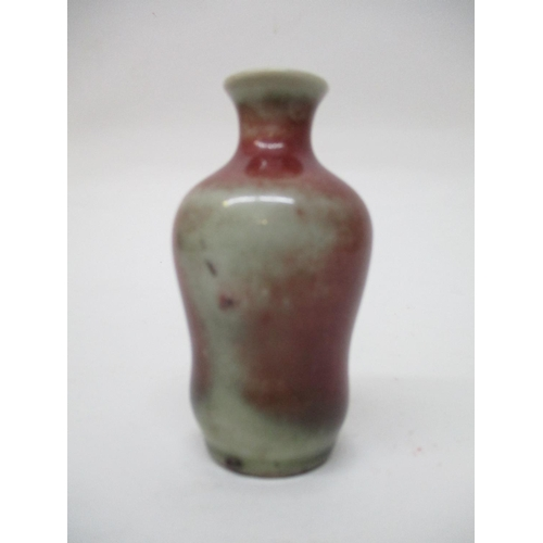 35 - An 18th/19th century Chinese miniature vase of wasted form with a flared base, shoulders and a waste...