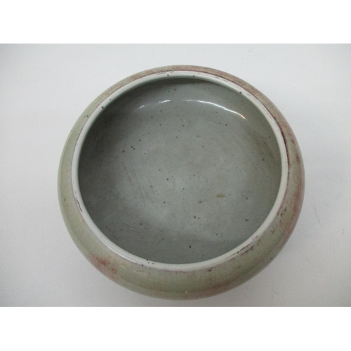 36 - An 18th/19th century Chinese bowl of flattened, bulbous form with a rolled over lip, on three moulde...