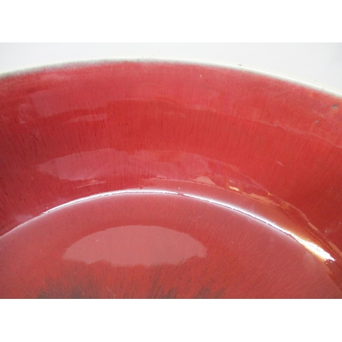 44 - An 18th/19th century Chinese bowl with curved sides in a streaky red/brown glaze fading to a cream r...