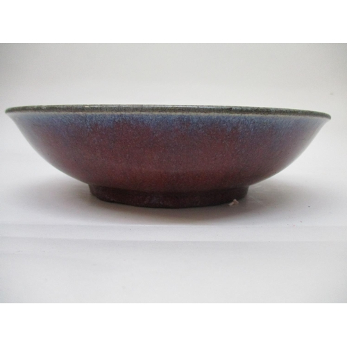 47 - A 17th/18th century Chinese dish with curved sides and a slightly flared rim in a speckled dark and ...