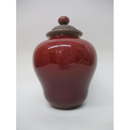 48 - An 18th century Chinese jar and cover of bulbous form with a narrowed base, short neck, domed cover ...