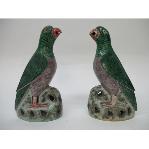 10 - A pair of 18th/19th century Chinese model parrots with a red beak, an aubergine chest and green plum...