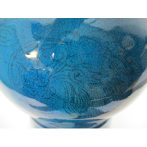 11 - A 19th century Chinese gu beaker vase with a flared rim and foot, incised with a bird, a dragon and ...