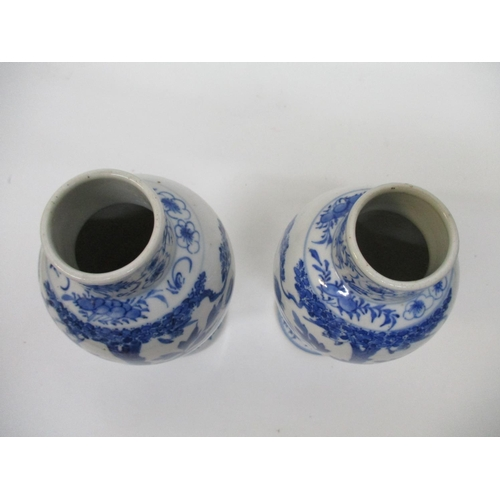 12 - A near pair of 19th/20th century Chinese blue and white vases with tapered, baluster bodies and shor...