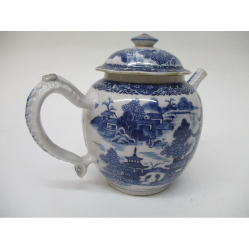 13 - A late 18th century Chinese blue and white teapot of bulbous form with a moulded handle, spout and d...