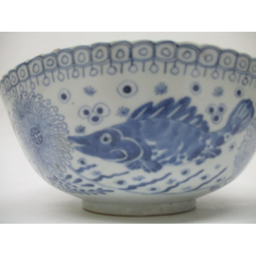 14 - A 19th century Chinese blue and white bowl decorated with a fish and plants within a band of leaves ...