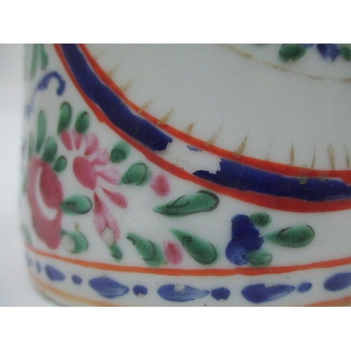 16 - A late 18th century Chinese famille rose tankard of cylindrical form with a crossover handle, decora...