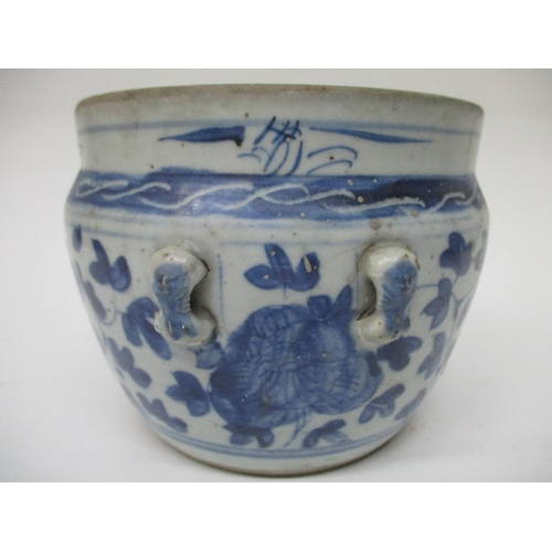 18 - An 18th century Chinese provisional blue and white vase with four handles, decorated with leaves, fl...