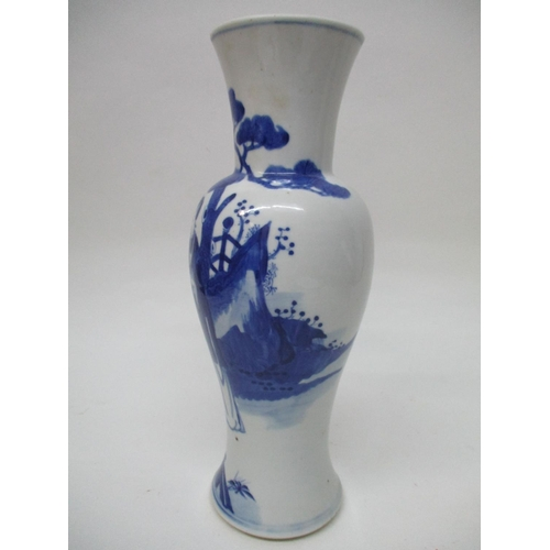 19 - A 19th century Chinese blue and white vase with a tapered baluster body, chamfered foot and flared n...