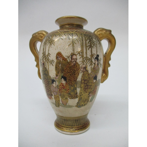 2 - A late 19th/20th century Satsuma vase of ovoid form with a flared lip and twin gilt handles, decorat...