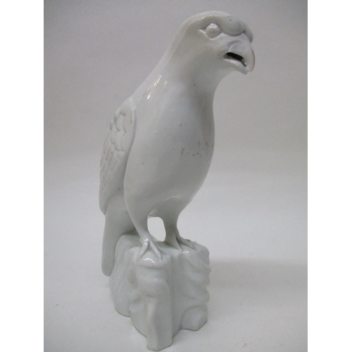 25 - A 19th century Blanc de Chine model bird with moulded wings, on shaped rocky base, 10 1/2