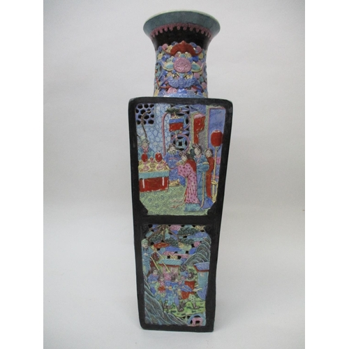 27 - A late 19th century Chinese vase of square, tapered form with pierced sides, decorated with panels o...