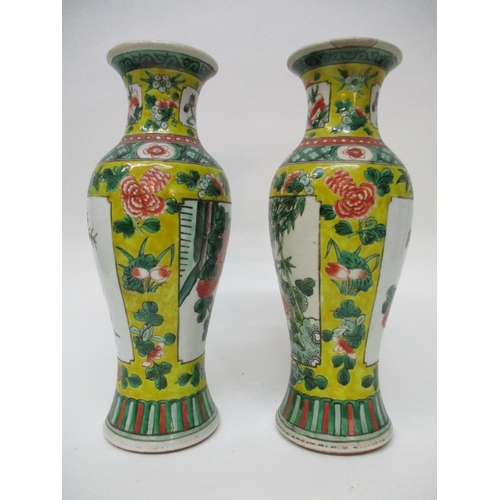 3 - A pair of early 20th century Chinese vases of ovoid form decorated with panels of flowers and bamboo...