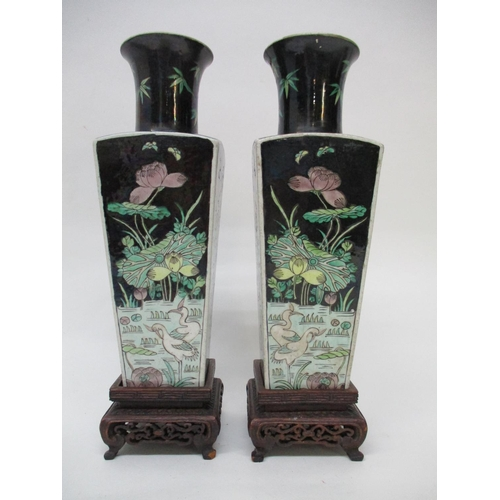 8 - A pair of 19th century Chinese vases of square tapered form with a flared neck, each decorated with ...