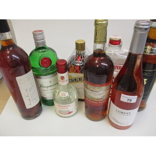 79 - One bottle of Tanqueray dry gin, 1ltr, a bottle of Beefeater dry gin, 1ltr, a bottle of Cointreau an...