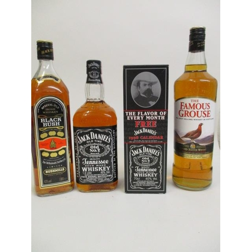 87 - Four bottles of Whisky to include Jack Daniel's, Famous Grouse and Black Bush Location 8.4...