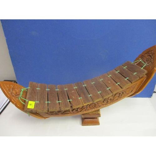 38 - A Chinese wooden instrument...