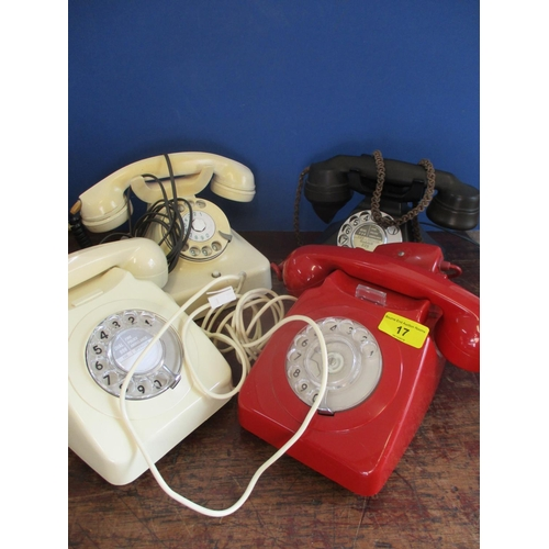 17 - Four vintage telephones to include a black Bakelite example with a drawer, an ivory coloured one wit...