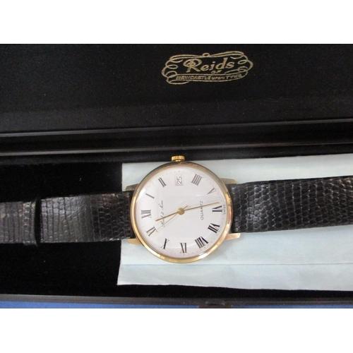 21 - A Reid & Sons 9ct gold cased wrist watch, a Newridge gents wrist watch, a Lotus quartz wristwatch an...