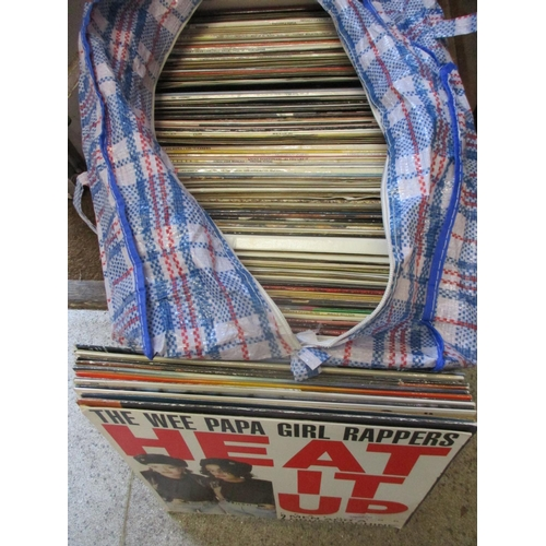 24 - A collection of vinyl records to include pop, rock and easy listening disco etc...
