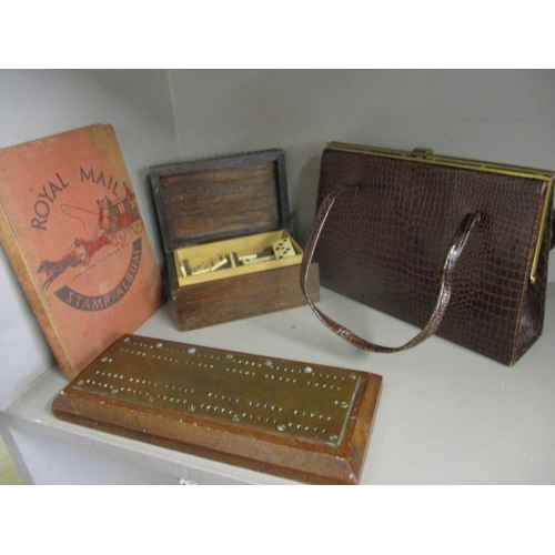 30 - A vintage reptile handbag, a complete vintage set of bone dominos housed within an early 20th centur...