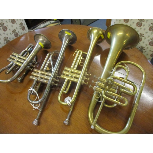 40 - A Besson & Co bugle, a B&M chapion trumpet and two other instruments...