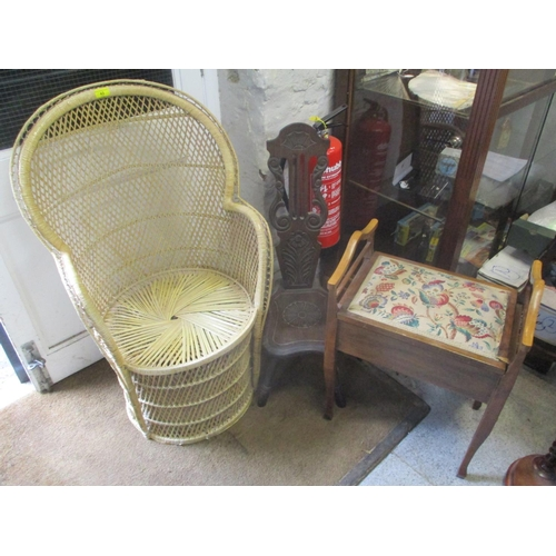 43 - A small wicker peacock chair, together with a spinning chair and a piano stool...