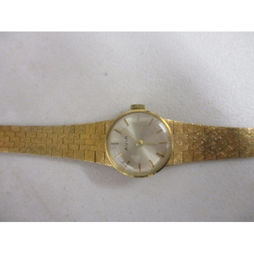 8 - An Avia 9ct gold ladies wristwatch with a textured flexible strap...