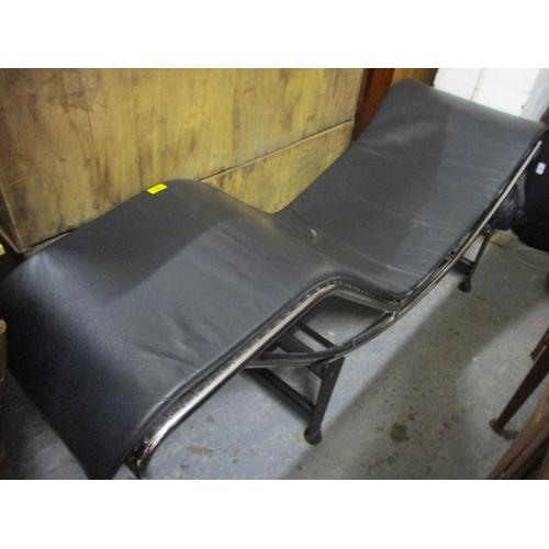 18 - A modern Corbusier design black leather adjustable chaise longue...