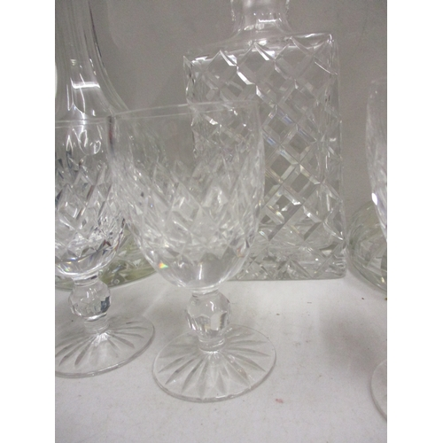 7 - Glassware to include a set of six Waterford pedestal glasses, three decanters, a vase and an ice buc...