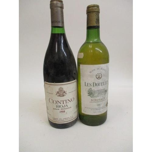 117 - A bottle of Costino, Rioja Gran Riserva 1980 and a bottle of Les Douches, Bordeau blanc de blanc 198...