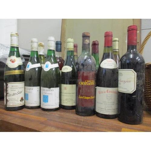 121 - Thirteen bottles to include Antinori, Vinsanto 1985, Macon Lugny Les Charmes 1985, Ropiteau, Chassag...